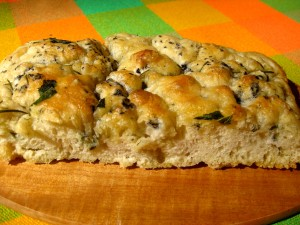 The amazing no knead faux-caccia covered with rosemary, sage, black salt and olive oil.  YUM.