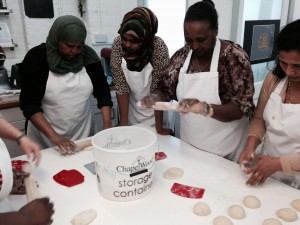 Ladies from Ethiopia, Somalia and Somaliland learning to bake bread.
