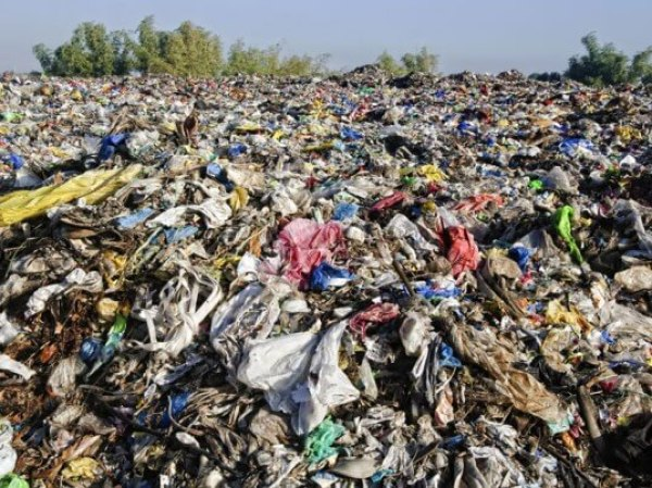 Landfill with discarded clothing