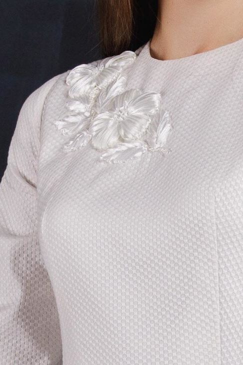 Close Up Tznius Ivory Wedding Dress with Embroidery