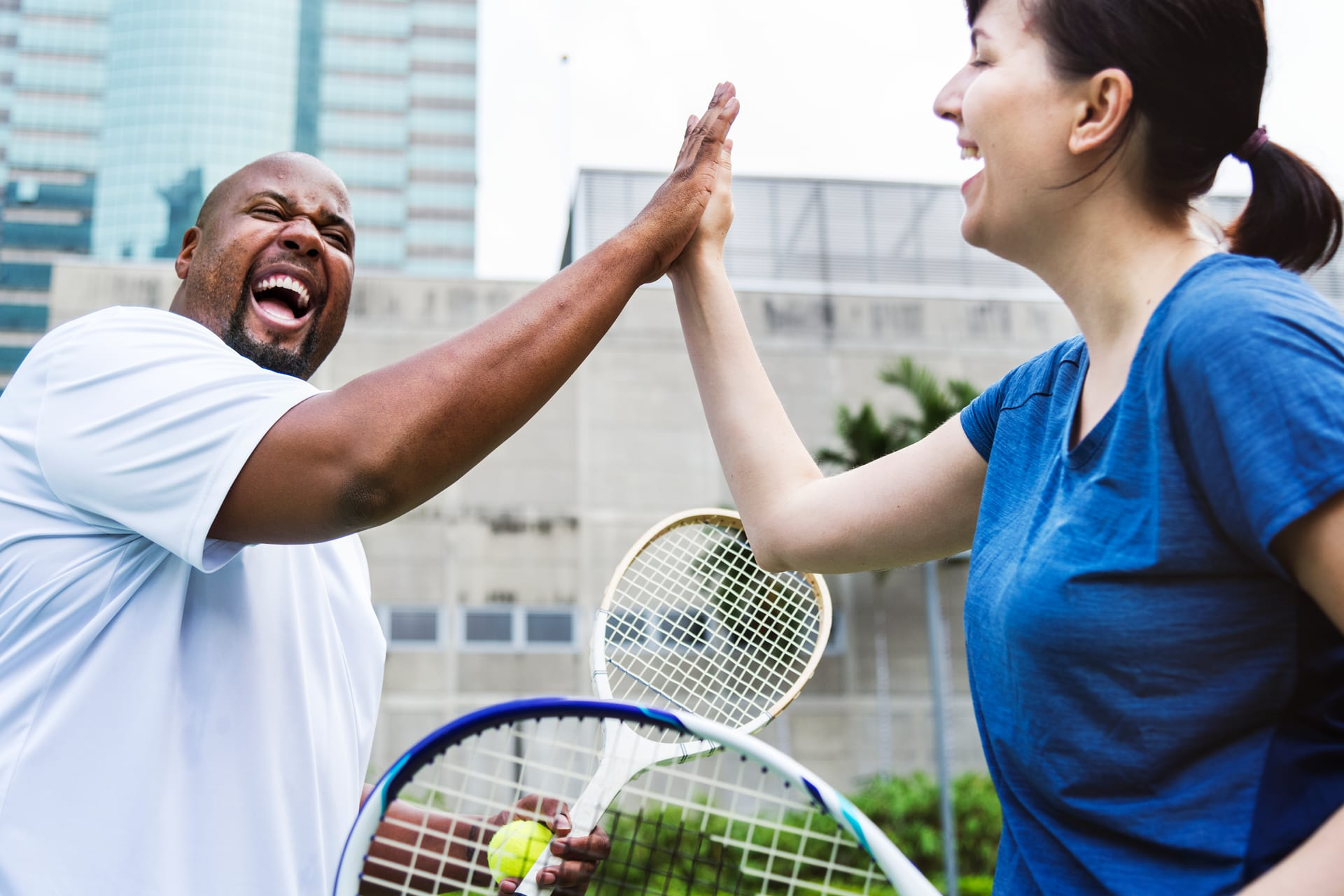 Hit your small business marketing goals like this couple hit that tennis score!