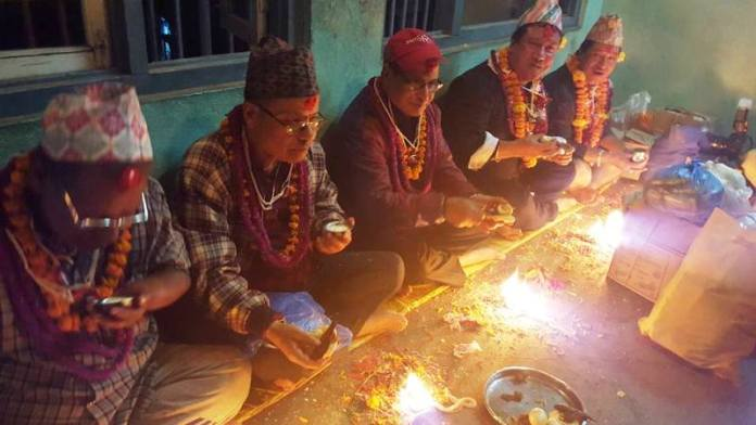 Nepalese traditional calture of Glories Mha Pooja. Worshiped self. Vetran Nepalese Artist Manish Kumar Shrestha with his relatives.