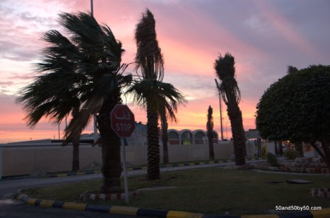 a rainbow of colors in the sky for the drive on the King Fahd Causeway