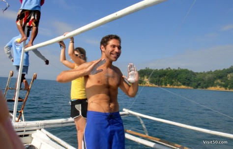 on a boat to swim with whale sharks