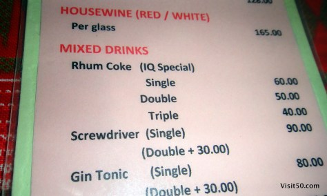 menu showing the rum costs less than coke
