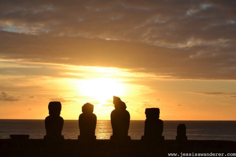 Sunset silhouette of moai in Chili