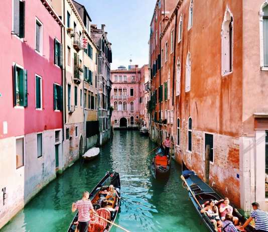 Italy travel, boat, canal, pink buildings