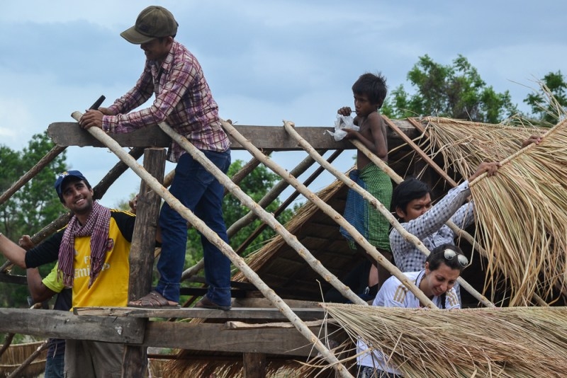 Volunteers help build a roof in Banteay Chhmar village