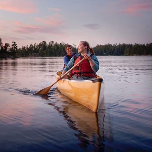summer trip couple canoe in boundary waters