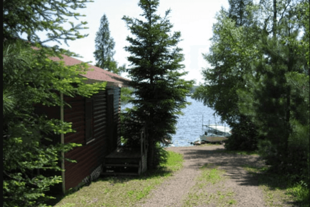 Exterior image with path to lake at Devil's Track Cabin