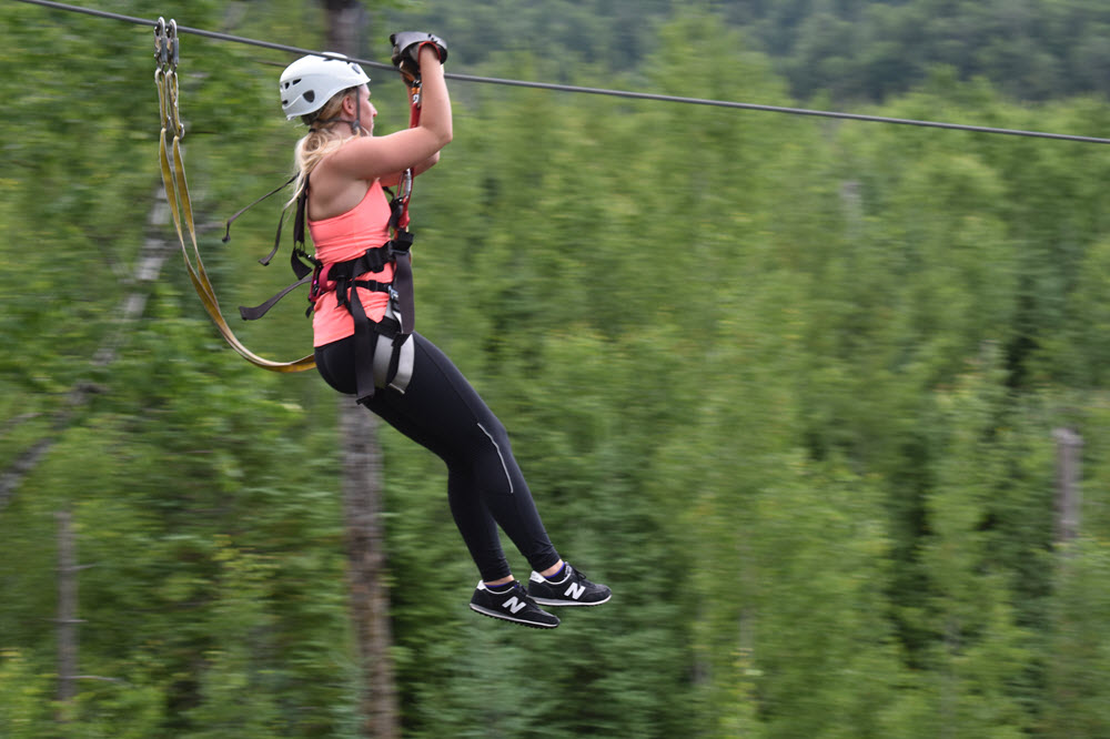 Gunflint Lodgte Towering Pines Canopy Zip Line Woman