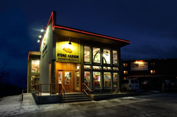 Nighttime storefront image of Stone Harbor Wilderness Supply