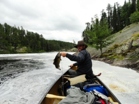 Tuscarora Lodge & Canoe Outfitters fishing from the canoe