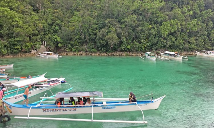 Tourists Board Boats In Sugba Lagoon In Del Carmen. Mayor Coro Works To Balance An Eco Tourism Boom With The Needs Of Local Fishers.