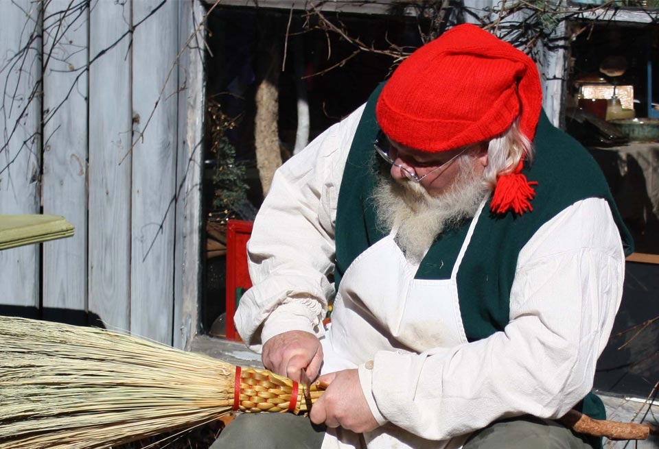 Image of man making broom