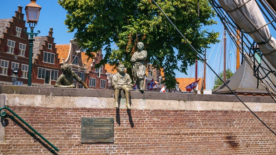 A view on old statues on a dyke in the harbour of the city of Hoorn, The Netherlands