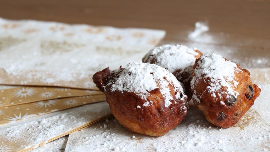 Oliebollen, Dutch fried dumplings, with powdered sugar
