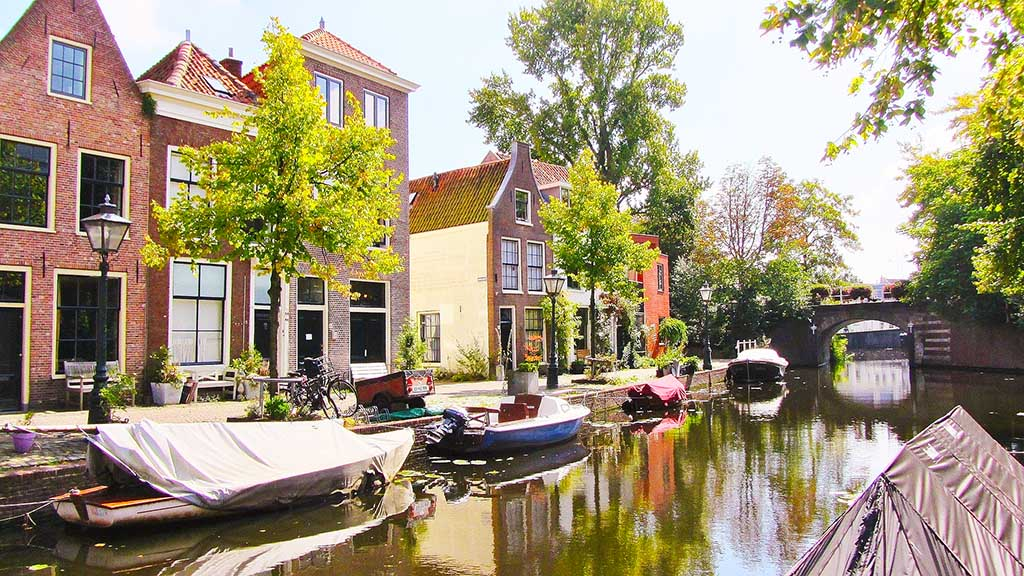 a view on a dutch canal and old brick canal houses in the city of Leiden, The Netherlands