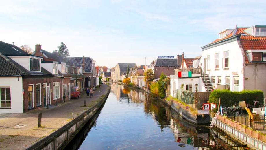 A photo of Woerden, with a canal in the middle and historic houses on both sides