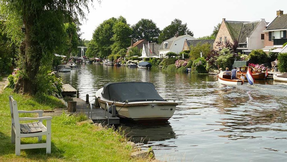 Dutch rivers with boats sailing during a beautiful sunny spring summer autumn day in The Netherlands in the Vecht region