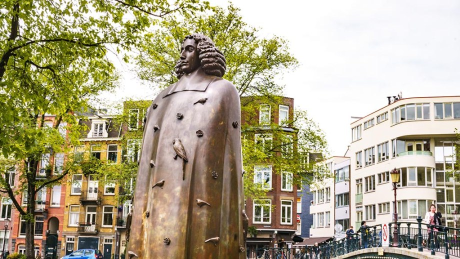 The Spinoza statue in the beginning of the Jewish neighbourhood of Amsterdam The Netherlands