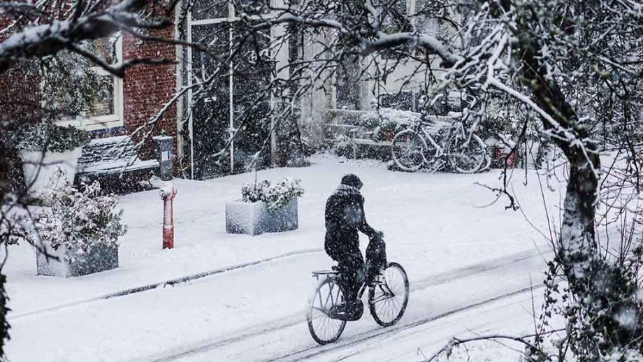 Cyclist in winter snow in The Netherlands