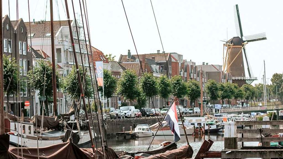 Historic part of Delfshaven with a view of the windmill in Rotterdam