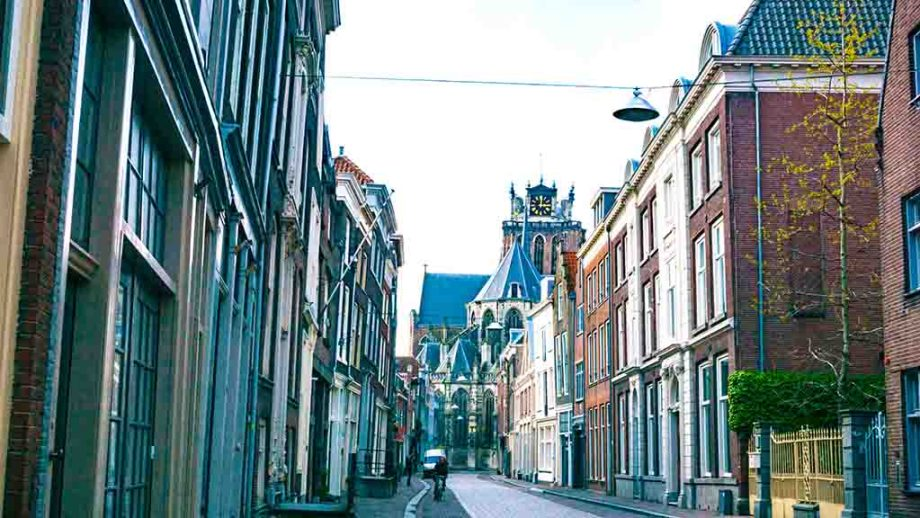 View on the grote kerk through one of the photo spots in the town of Dordrecht, Zuid- Holland, The Netherlands