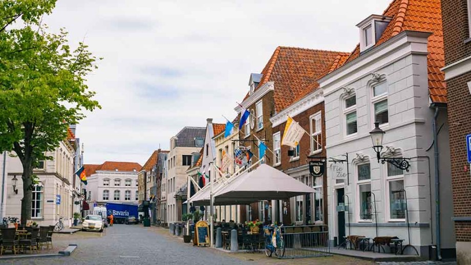 view on the main cobblestoned square in the Dutch town of Ravenstein, The Netherlands