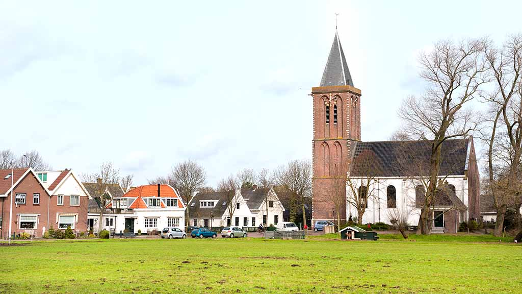 Typical Dutch agraric village with church and farm houses