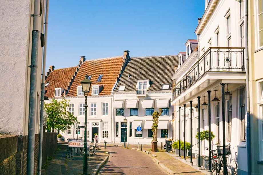 View on a cobblestoned street, surrounded by white brick buildings in Wijk bij Duurstede, The Netherlands