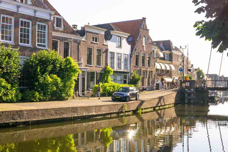 A view on a canal and canal houses during a summer day in the town of Maarssen, The Netherlands