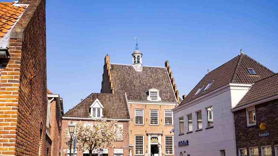 Photo of old Dutch brown brick houses in the town of Montfoort, The Netherlands