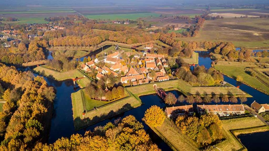 Aerial view of Fortification village of Bourtange. This is a historic star shaped fort in the Province of Groningen seen from above in autumnal colors