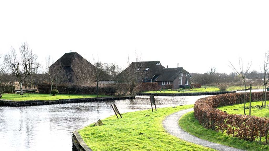 View of houses and canals in the village Dwarsgracht near Giethoorn, The Netherlands