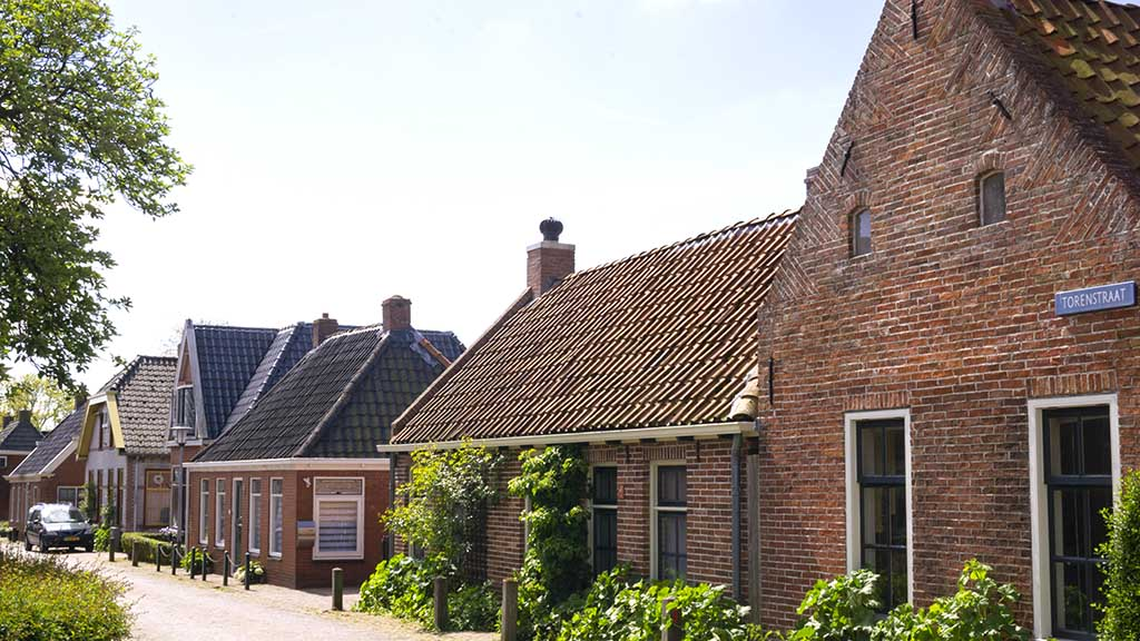 A view on old brick Dutch houses in the village of Ezinge
