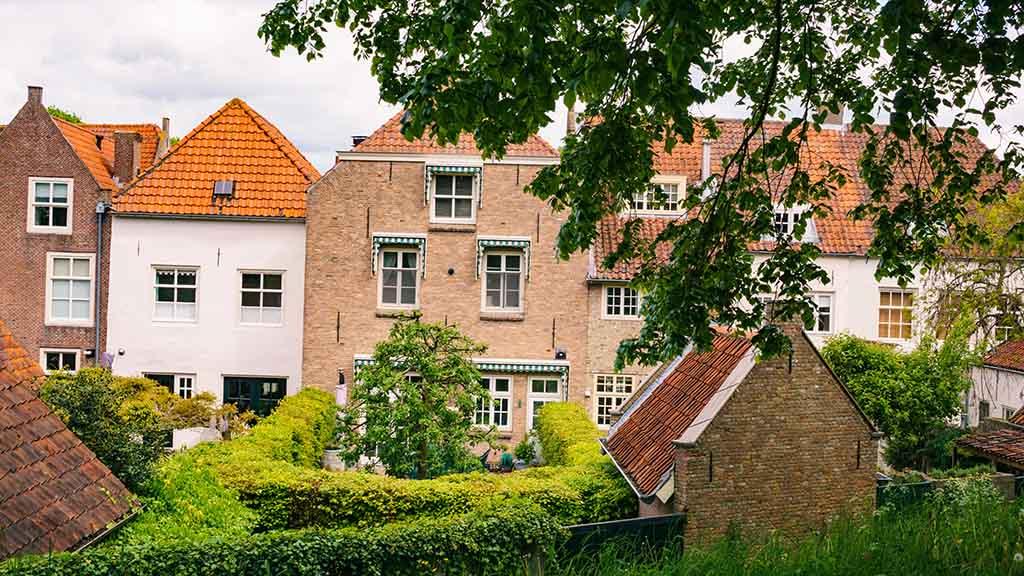 view from ramparts of Heusden on brick houses with a green garden in Heusden, Noord- Brabant, The Netherlands