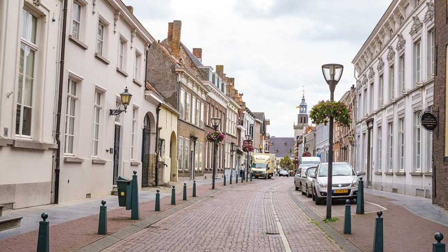a view on historic dutch buildings along a cobblestoned street in Hulst, Zeeland, The Netherlands
