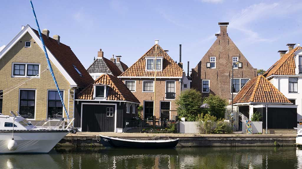 A view on beautiful brick canal houses in the frisian town of Makkum, Friesland, The Netherlands