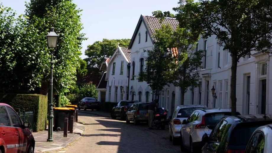 view on white houses along a cobblestoned street in Nigtevecht, The Netherlands