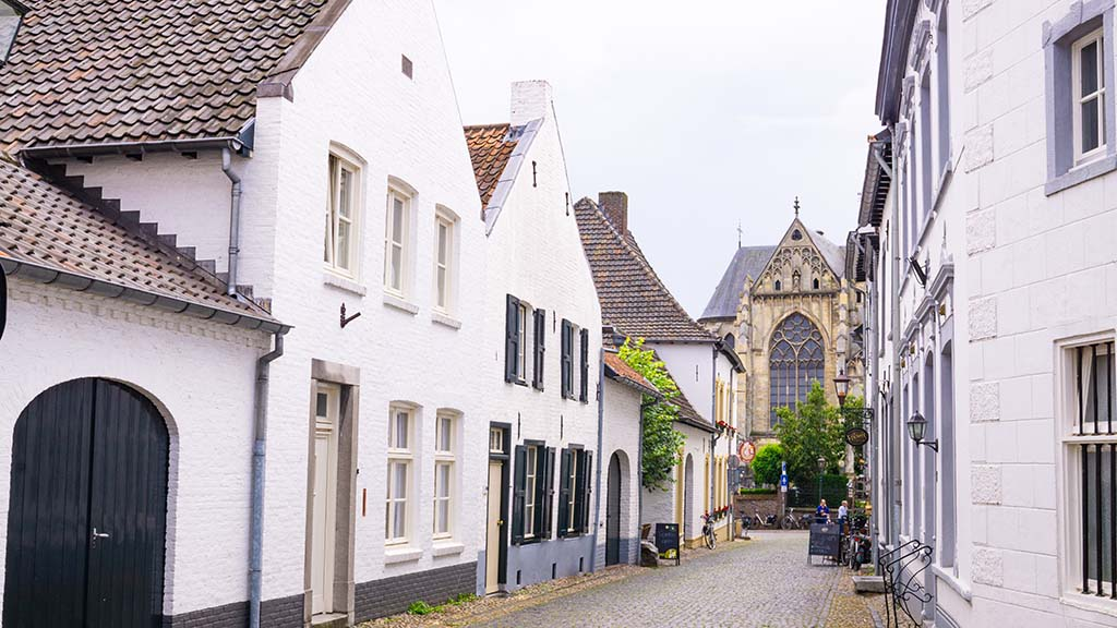 View on white buildings and the main church in the white town of Thorn, Limburg, The Netherlands