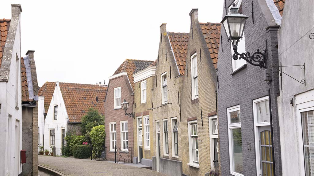 View on a historic street with canal houses in the town of Zwartewaal, The Netherlands