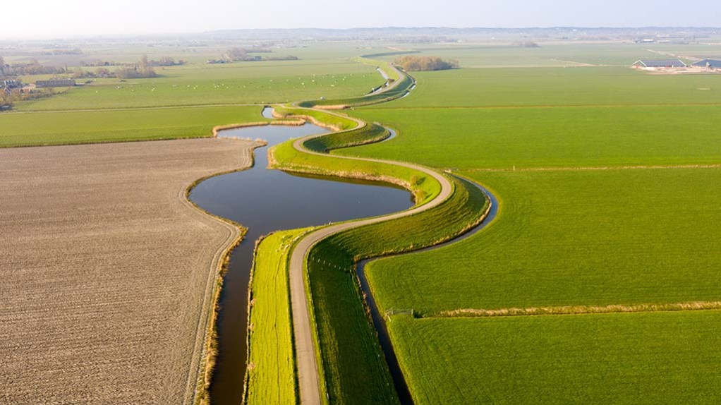 View on a dyke with two lakes that surround the Westfriesland region in The Netherlands (Noord North- Holland region)