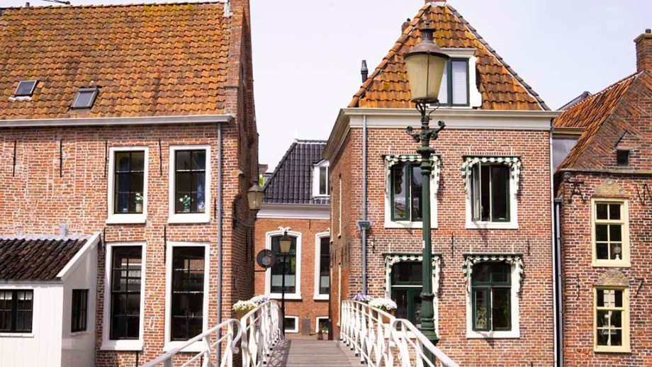 View on a bridge and historic buildings in the city of Appingedam, Groningen, The Netherlands