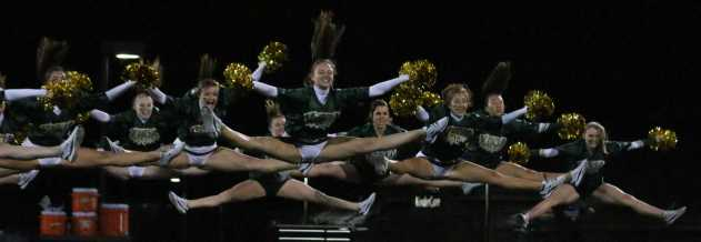 Varsity and JV poms perform together during the half time show.