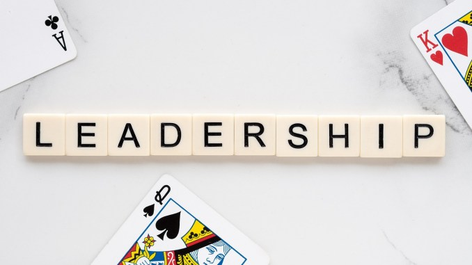 the word LEADERSHIP with court cards from a deck of playing cards