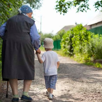 great-grandmother-and-toddler-boy-walking-down-PCXCP7Q