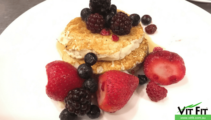 Healthy Pancakes with high protein and low carbohydrate topped with fresh strawberries, blueberries and raspberries.
