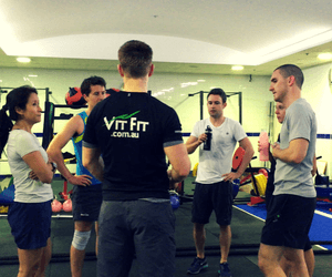 Group of participants talking with their personal trainer
