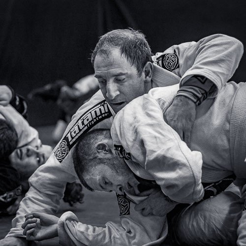 Alex finishing an armdrag to toms back in the BJJ class